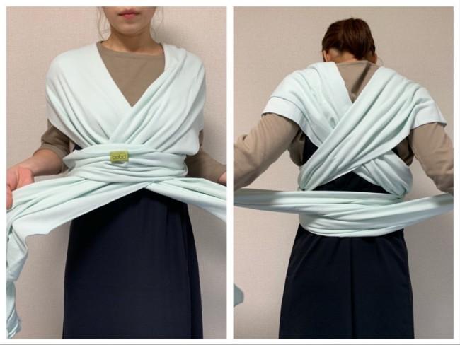 胴回りに巻いた布に、垂らした部分を入れて引っ張ります