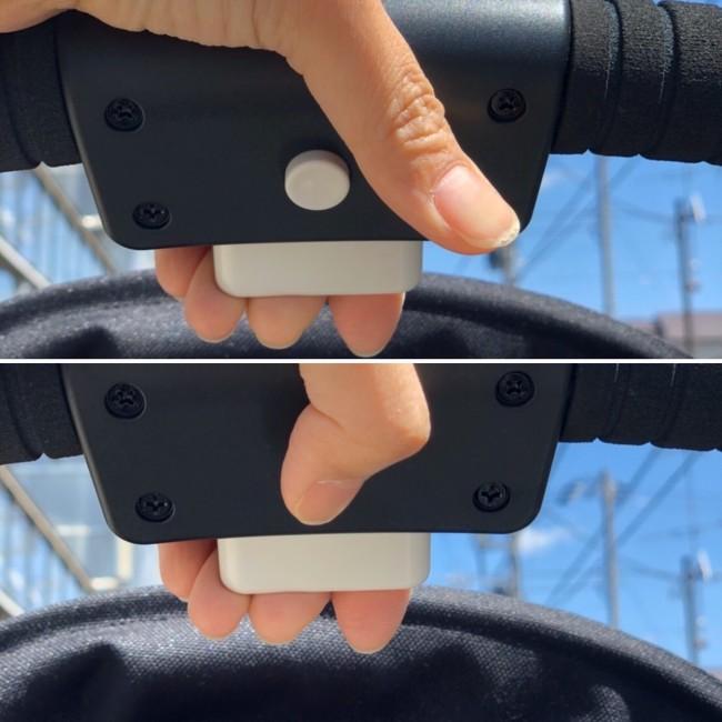 ハンドルに付いているボタンを押し、握りながら開閉を行います